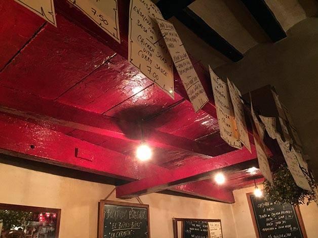 el bitxo menus hanging from the wall