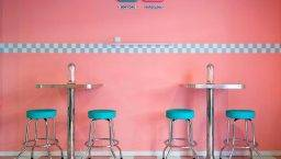 peggy sue pink wall and stools