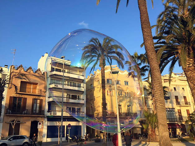 sitges and palm tree in soap bubble