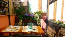 terrace and breakfst table hostal poblenou